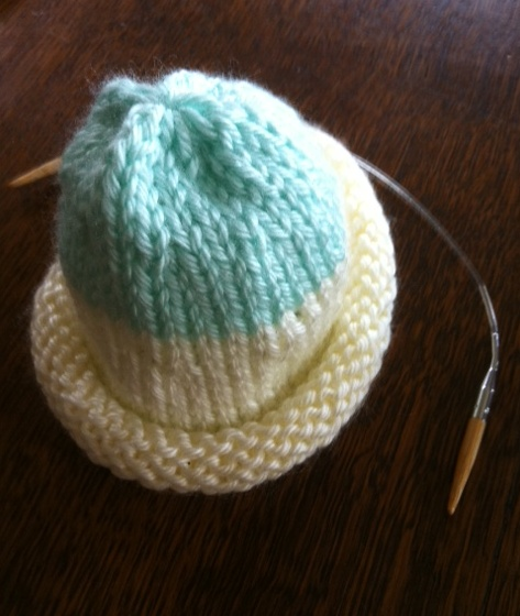 Cap made of two colors and knitting needle