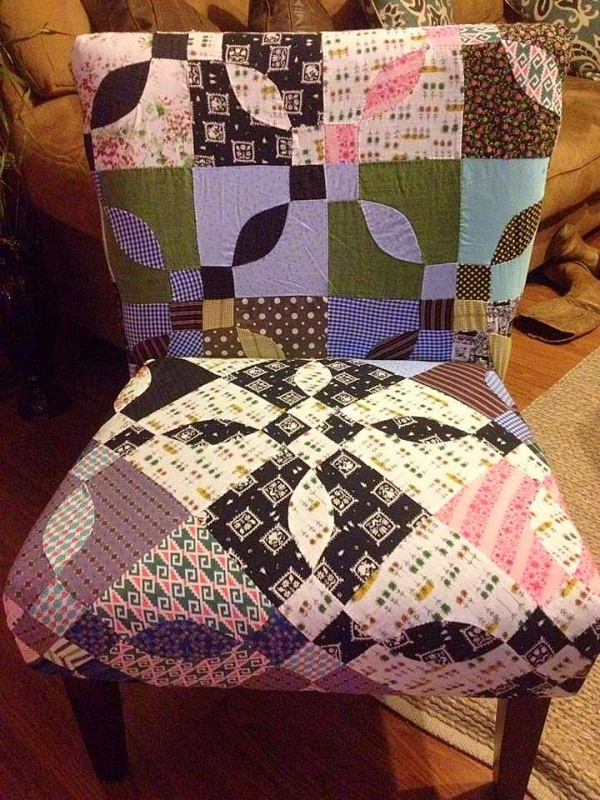 I used an old hand quilted top to reupholster a chair